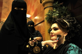 A Saudi woman applies makeup on a model during a beauty and style competition on the sidelines of the 2010 Cosmetic Expo, a four-day exhibition held for the first time in Saudi Arabia, at a hotel in the coastal city of Jeddah late on December 21, 2010. AFP PHOTO/AMER HILABI (Photo credit should read AMER HILABI/AFP/Getty Images)